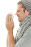 Man with flu and tissue Royalty Free Stock Photos