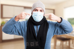Man with flu wearing a face mask Stock Photography