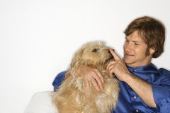 Man with fluffy brown dog. Stock Photo