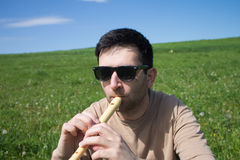 Man with a flute Royalty Free Stock Images