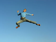 Man fly. On blue sky royalty free stock image