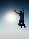Man fly in air. Blue  Toned effect. Man falling down with hands up. Stock Photos