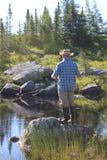 Man fly fishing Stock Photography