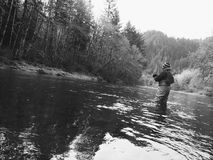 Man Fly Fishing in Cold Winter Weather Stock Photography
