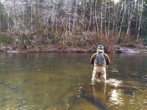 Man Fly Fishing in Cold Winter Weather Stock Images