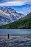 Man Fly Fishing in Kintla Lake