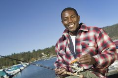 Man fly fishing on lake Royalty Free Stock Photos