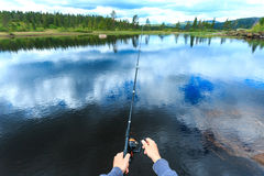 Man fly-fishing in Norway Royalty Free Stock Photos