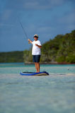 Man fly fishing on a paddle board Royalty Free Stock Photo