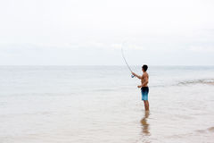 Man fly fishing Stock Image