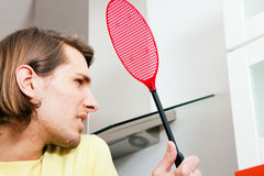 Man with a fly swat Stock Image