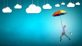 Man fly on umbrella Stock Image