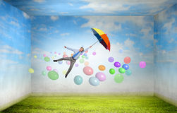 Man fly on umbrella Royalty Free Stock Photography
