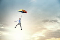 Man fly on umbrella Royalty Free Stock Images