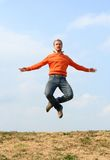 Man flying. Happy expressive man jumping high and screaming Stock Photo