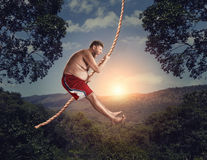 Man flying in the air by rope Royalty Free Stock Photos