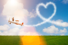 The man flying airplane and making heart shape Royalty Free Stock Image