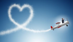 The man flying airplane and making heart shape Royalty Free Stock Photo