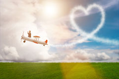 The man flying airplane and making heart shape Stock Image