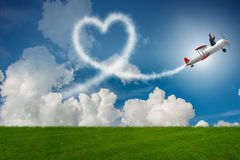 The man flying airplane and making heart shape Royalty Free Stock Photos