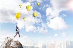 Man flying on a balloon Stock Photo