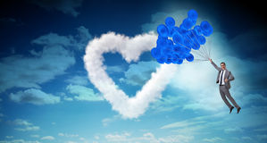 The man flying balloons in romantic concept Stock Photography