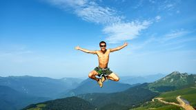 Man is flying on beautiful backgroung of mountains, Krasnaya Polyana royalty free stock image
