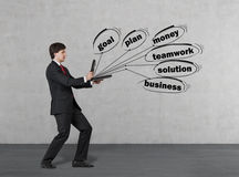 Man and  flying business words Stock Images
