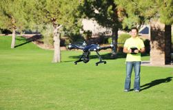 Man Flying A Camera Drone (LARGE FILE) stock photos