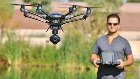Man Flying A Camera Drone UAS (Wide-Screen & Large File) Stock Photo