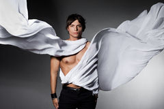 Man with flying cloth Stock Photography