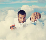 Man flying through the clouds Royalty Free Stock Image