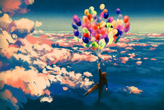 Man flying with colorful balloons in beautiful cloudy sky Stock Images