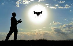 Man flying drone outdoors royalty free stock images