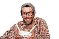 Man with flying drone. Studio shot on white background. Royalty Free Stock Photos