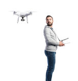 Man with flying drone. Studio shot on white background, isolated Stock Photos