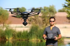 Man Flying a High-Tech Camera Drone royalty free stock photos