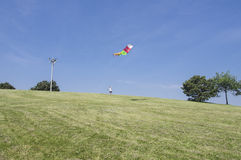 Man flying his kite Stock Photos