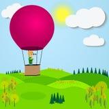 Man flying hot air balloon over the a mountain Royalty Free Stock Photos