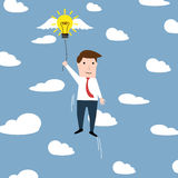 Man with a flying idea bulb in clouds Royalty Free Stock Photography