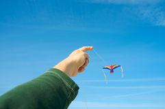 Man flying a kite Stock Photo