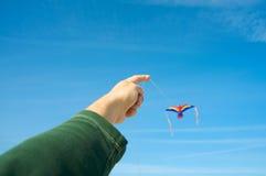 Man flying a kite Stock Photo