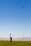 Man flying a kite Stock Images