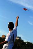 Man flying kite. In the parks Royalty Free Stock Photography