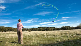 Man flying a kite Stock Image