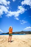 Flying a kite. A man is flying a kite on a tropical beach in the Caribbean stock photography
