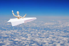 Man flying over clouds in the toy paper plane Royalty Free Stock Photography