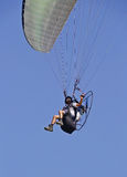Man flying on a parachute Royalty Free Stock Image