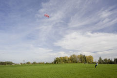 Man flying a power kite Royalty Free Stock Images