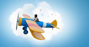Man flying in retro plane. Mixed media royalty free stock photography